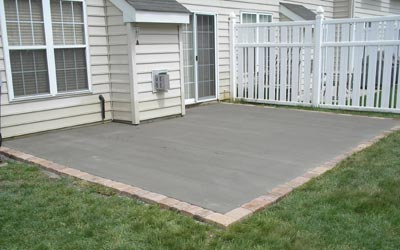 Newly poured concrete patio with EP Henry Paver border