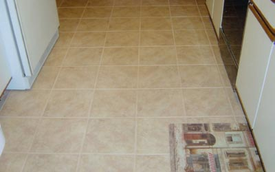 Finished ceramic tile kitchen floor close-up